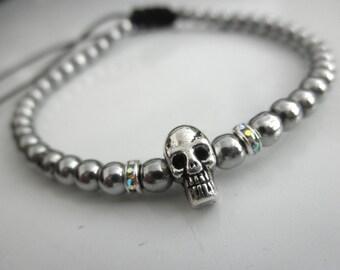 Tiny skull bracelet with silver beads