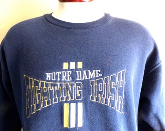 Go Fightin' Irish vintage 90's UND University of Notre Dame navy blue fleece yellow white embroidered logo graphic sweatshirt crew neck Larg