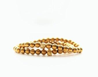 Gold Hematite Gemstone and Brass Skull Stackable Bracelet