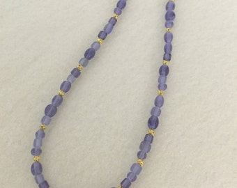 Pretty light purple and gold necklace.