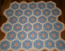 cute and snuggly hand crocheted hexagon flower baby blanket, afghan