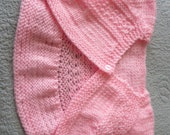 Hand knit pink lace baby girl shrug or bolero