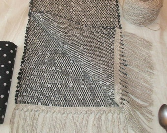 "table runner, handwoven,..dark grey  and white...  , rag  type,..   linen, cotton, rayon,.. 36"" plus 4"" fringe  44"" long x 12""wide"