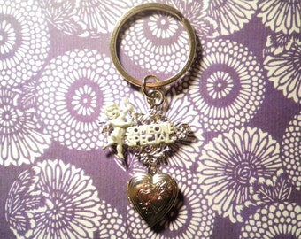 "2 Silverplated ""Someone Special"" Angel Key Chains with Heart Locket"