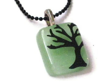 Fused glass pendant necklace - winter tree silhouette on mint glass