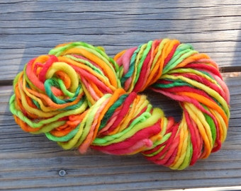 Hand spun yarn - hand painted kent romney wool - thick and thin - 4 oz. - 65 yards