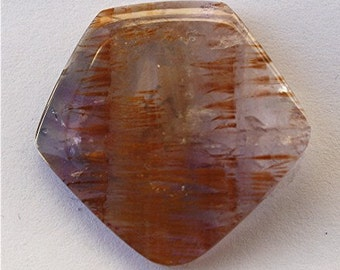 Cacoxenite in Amethyst Cabochon
