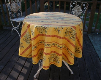 """Round tablecloth.French cotton coated.oilcloth.52"""" diameter.Fabric from Provence.Gift for her. Olives with stripes in a yellow backround"""