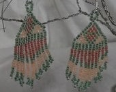 "Native American style Brick Stitch Earrings, using green, light peach and dark peach Miyuki Seed Beads 2 1/2"" long by 1"" wide"