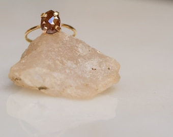 Conflict-free pear brown rosecut diamond solitaire