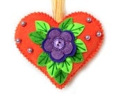 Valentine's Day Ornament made out of felt . Decorated with beads. Heart cushion