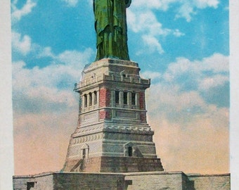 Statue of Liberty vintage postcard. New York postcard from the 1930's. Bi-plane overhead. Unused condition.