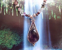 Language of Light Amethyst Tear Drop Pendant on a strand of Rainbow Fluorite and Tourmaline with Garnet accents..