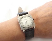 1965 Bulova Mid-Century Wristwatch Beau Brummel  White Gold Plate, Square Case, Oval Dial Diamonds at the Hours
