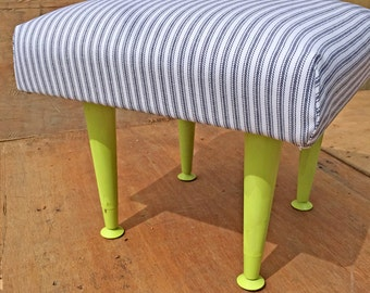 lime green metal legs with black and white fabric FOOTSTOOL. cute  addition to the living room OR bedroom (contact us for delivery quote)