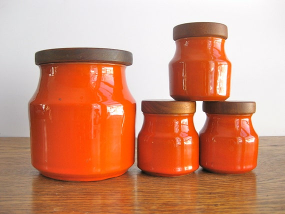vintage set of orange ceramic canisters with by