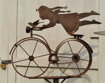 Go Girl 3 Birdie on bicycle with birds is a fun kinetic weathervane style recycled steel garden sculpture.