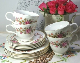 Vintage tea cup trio with pink roses,daisies and little flowers made by Crown Trent. Teacup, saucer and side plate / tea plate.