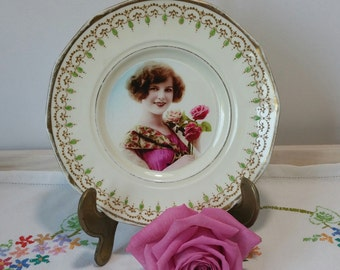 Vintage Decorative Wall Plate in bone china with centre image of beautiful lady holding a flower. PP020. PP021.