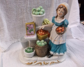 Vintage Woman working a Fruit Stand Figurine