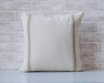 Decorative throw pillow made from grain sack farmhouse fabric.  Double tan stripe pattern. Pillow cover is available in different sizes.