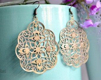 Pierced ears print bronze metal