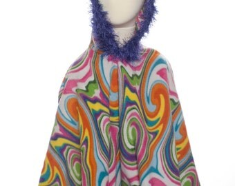 Marbled, multicolored girls poncho with purple fur trim.