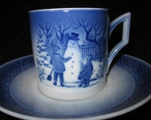 Royal Copenhagen Christmas  Cup And Saucer Set. 1985.  The Snowman, Danish Blue And White.