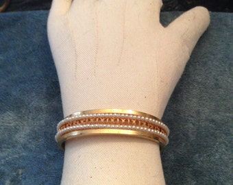 Vintage hinged cuff braclet with seed pearl settings in gold