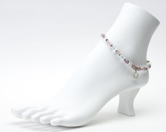 Tiara crystal anklet with silver charm.