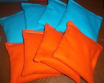 8 ACA Regulation Cornhole Bags - 4 Turquoise and 4 Orange Bags