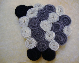 Recycled Felted Wool Sheep Trivet by FeltLikeItStudio will Brighten Up the Table