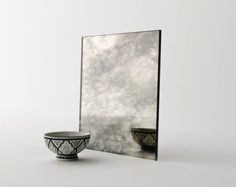 Stormy Antiqued Mirror by Mirror Coop. Handmade mirror perfect for custom furniture projects. Antiqued glass mirror by Mirror Coop.