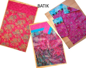 3 different Bright pink batik pillowcase with contrasting trim at opening