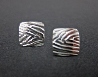 sterling silver earrings. square, textured, slightly domed
