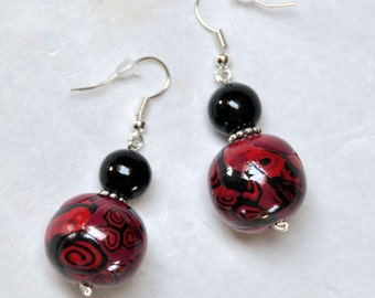 black and red graphic round earrings