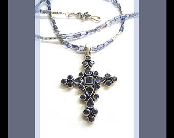 Seraphina: Amethyst and sterling silver cross suspended from an iolite necklace.