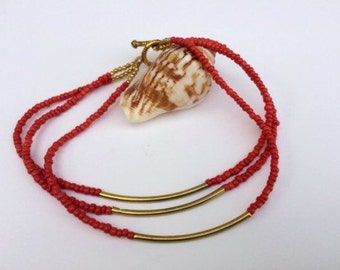 Red & Gold Plated Multi Strand Anklet.