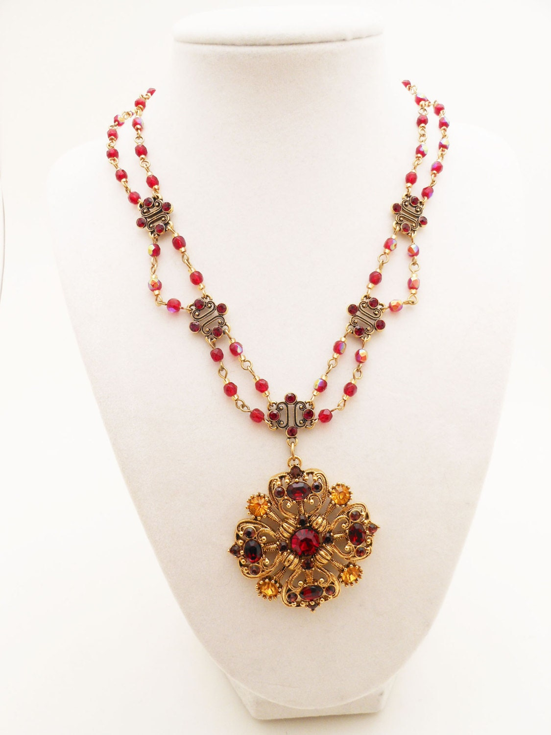 vintage avon necklace with red and gold rhinestones