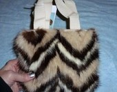 Brown, tan, and white mink fur purse from recycled coat