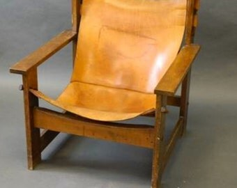 A Spanish leather and beech easy chair in the style of Borge Mogensen