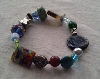 Green patterned stone, black & grey translucent bead, venetian glass bead, silver accents.