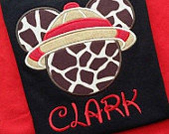 Mickey Mouse safari Giraffe animal print head with tan and red trim safari hat on black T-shirt. Inspired by Disney's Animal Kingdom.