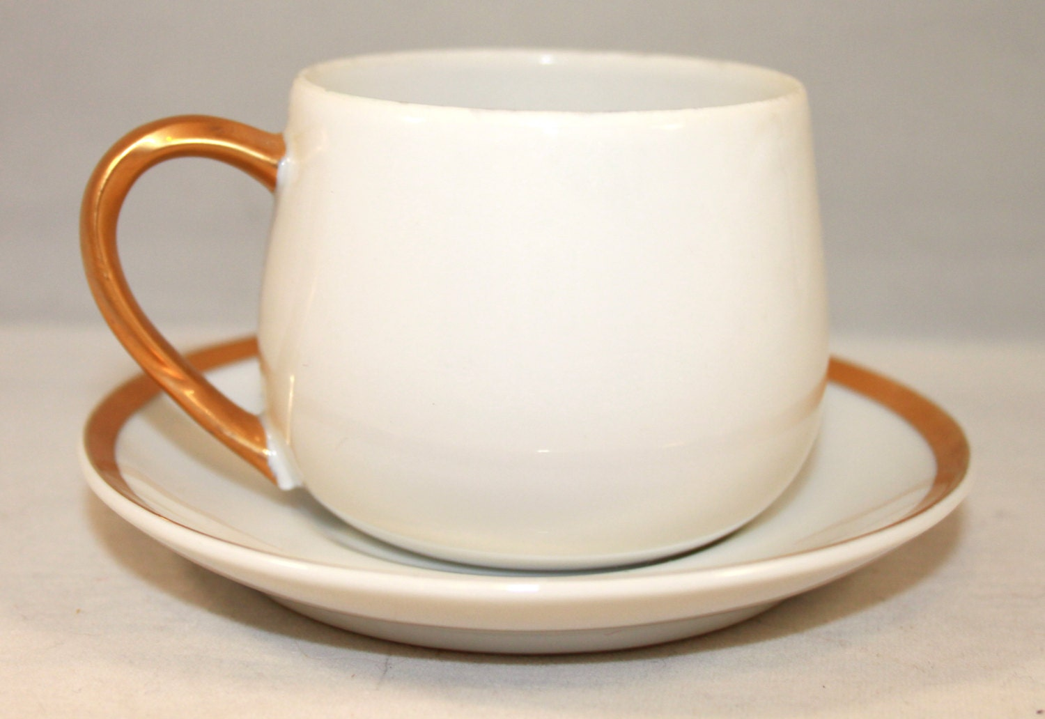 Fitz and floyd cup and saucer demitasse white with gold for Where can i buy canape cups