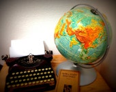 Marked Down///Vintage 12 inch Sculptural Relief Globe on Metal Stand, Rotates and Spins Great Condition
