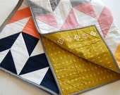 modern baby quilt, herringbone color block pattern in steel gray, navy, carnation pink, coral, and sunny yellow.