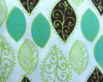 """Mint, Lime, and Chocolate Leaves on White Cotton Fabric.  44"""" wide sold by the yard"""