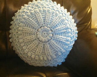 Decorative crocheted pillow with woven pattern
