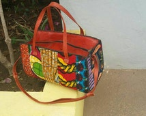 10% off Use discount code DISCOUNT10  - Stylish African Print Leather mix Handbag in 4 Colours