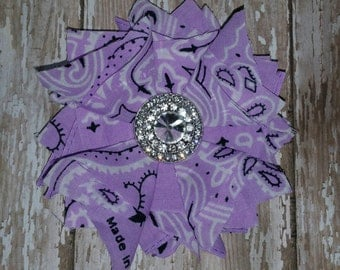 Fabric Flower with Rhinestone center on alligator clip.